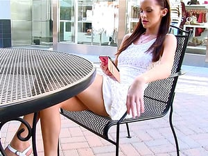 A long-legged brown-haired doll ambles naked in the street and masturbates