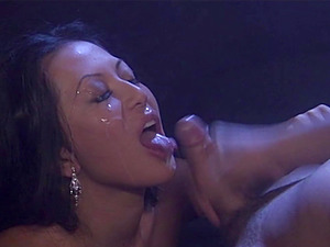 A smoking hot Asian siren is sucking a man rod at the movie