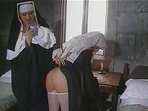 Two horny nuns fucktoy each others beavers in a convent