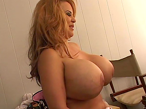 She is an gross mummy with large tits that she shows