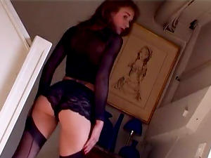 Brown-haired in a see thru half-top has a stunning figure
