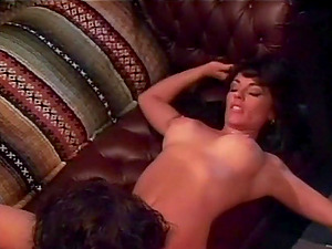 Big-boobed dark haired seductress blows massive dick and rails it on top