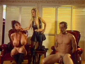 Blonde mistress predominates chesty brown-haired and her hubby in FFM clip