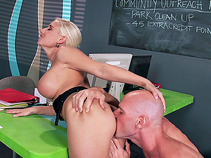 Delightful blonde stunner with faux tits likes getting pounded hard-core rectal