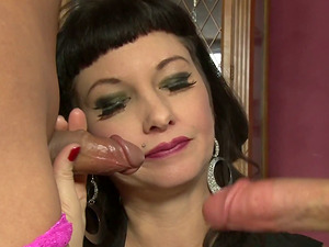 Horny tranny and a black-haired bitch share a dick in the living room