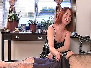 Horny red-haired drains a fellow off while showcasing her tits