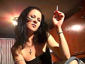 Horny Black-haired In Blue Jeans Smoking Cigar Indoors
