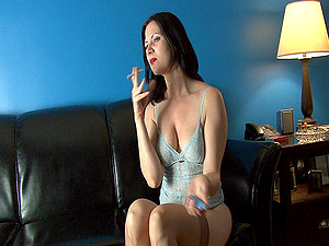 First-timer black-haired cougar smokes and strokes her tits and vagina