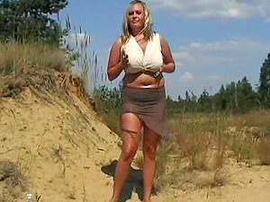 Stunning Solo Model In Miniskirt Displaying Her Natural Tits