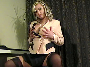 Chubby blonde Malina May licks her big breasts and frigs her vagina
