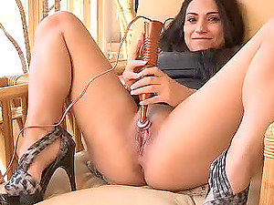 Dark-haired Rikki is masturbating with a wand in high high-heeled shoes