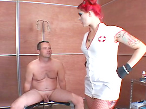 Queen Soma uses some metal devices in female domination ball busting clip