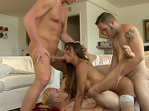 Fabulous shemale in nylon stockings gets her manstick sucked before being pounded in a wild groupsex shoot