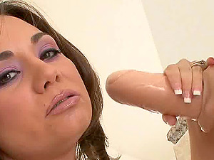 Solo stunner Holly West and her monster fake penis have a good time