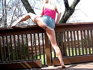 Salacious blonde flashes her big tits in saucy outdoors shot