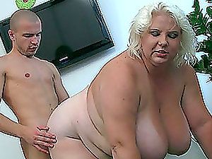 A bony boy has an incredible fuck with a big fat mature woman
