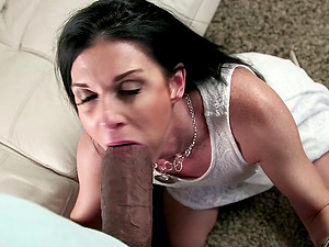 Flirtatious cougar gives a big black man rod a fellatio then takes it up her labia
