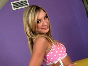 Amy Brooke groans in pleasure with her head pinned on the cushion while bearing a doggystyle