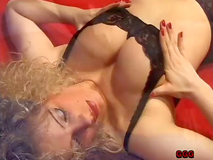Dirty blonde cougar with massive tits and a nice big bootie loving a mind-shattering gang-fuck