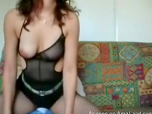 Sexy Latina in black undergarments railing a big dick on a sofa