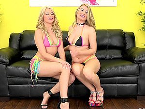 As the audience on webcam cheers these two chicks grind cootchies