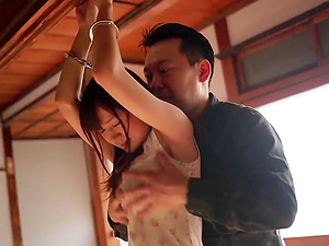 Cuffed Japanese beauty fucked and taking a facial cumshot