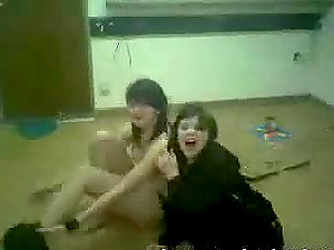 Two tipsy teenagers dance and let their classmate film them