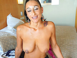Pierced and tattooed tits on this hard-on thirsty cougar