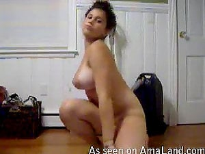 Clumsy Latina nubile has joy with a lollipop in front of the webcam