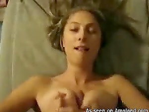 A hot doll gives a tit job and gets a jizz flow to her nice hooters