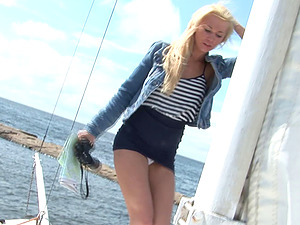 Long legged blonde beauty unwrapping on a yacht to flaunt her hot figure