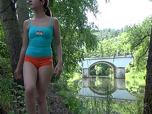 Cutie in the forest takes off her underpants to masturbate