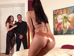 Bi-atch in a shiny bathing suit entices a duo into fucking her