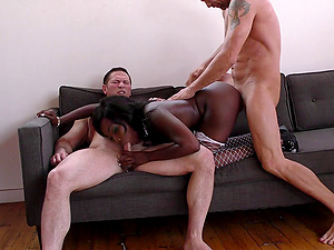 Alluring chocolate lady is encircled with milky dicks in a gang-bang