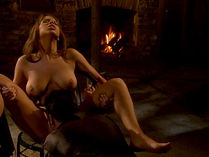 Romancing his lady outdoors by the fire and fucking her hard
