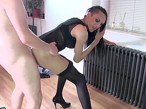Arousing dark-haired shemale and her bald paramour having some joy
