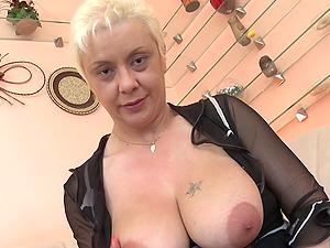 Taut shiny corset looks hot on this whorey mature blonde