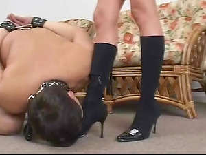 Stomping mistress likes it when he inhales on her toes