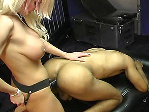Dark-hued man gets his asshole fucked by a wild domme