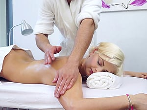 Blonde with a delicious assets lets the masseuse explore her pink innards