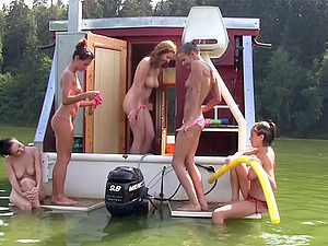 Kinky lezzy activities of the hot chicks on their diminutive yacht