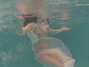 Provocative honey wearing a mesh sundress strips inwards of the pool