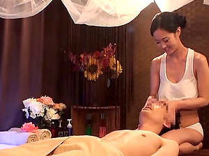 Breathtaking massagist from Japan plays with the boner after the rubdown