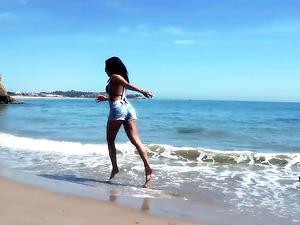Slender Spanish Latina fucks herself on the beach