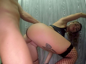 Dark-haired Medusa in a kinky attire spreads her gams for a hard-on