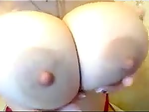 Honey inhales a fuck stick and plays around with her large tits live on webcam