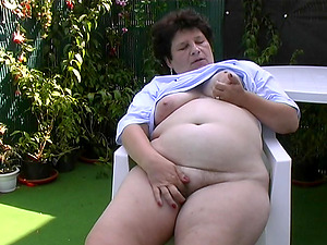 Fat mature Mischa has joy with her figure during an outdoor game