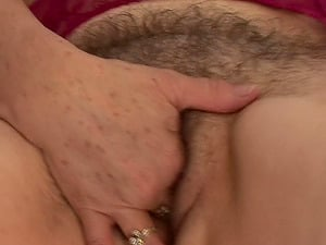 Elderly woman Petrina thumbs her hairy mature vulva