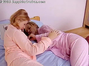 Two hot blondes eating each other and playing with a strap on