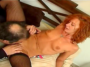 Mature redhead loves being drilled by an experienced lover